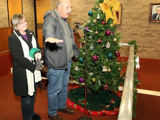 Cathi and Glenn Franzoi of Vineland, who donated this year's Christmas tree at Vineland City Hall, talk about how the roughly 25-foot-tall blue spruce was just 4 feet tall about 30 years ago.