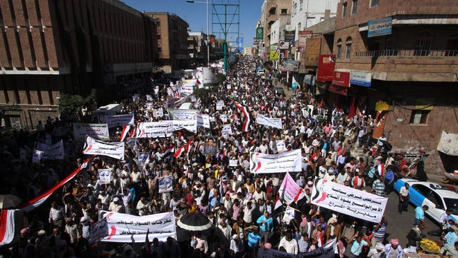 Yemeni protesters march to protest Houthi rebels in Taiz on Feb. 11.