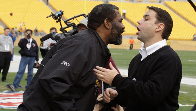 "Pittsburgh Steelers hall of fame defensive tackle ""Mean"" Joe Greene, left, is reunited with actor Tommy Okon on the field at Heinz Field before a NFL football game against the Cincinnati Bengals in Pittsburgh, Nov. 15, 2009."