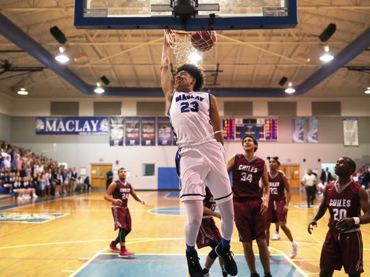 Maclay's Zim Nwokeji dunks the ball against Chiles during their game at Maclay School on Tuesday, Jan. 9, 2017.