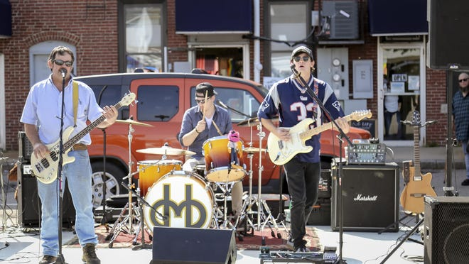 The band Dancing Madly Backwards performs in the Union Street parking lot during Rochester's 2018 Porch Fest. The multi-stage, citywide event is planned to return for its third annual festival Sept. 27, 2020.