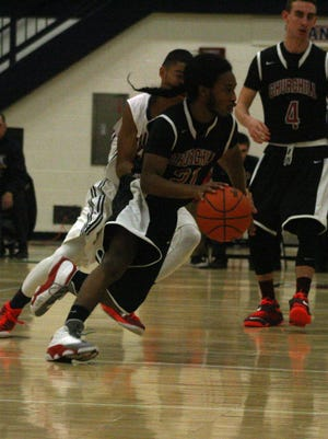 Churchill guard Dayton Davis drives to the basket during Monday night's victory over Franklin.