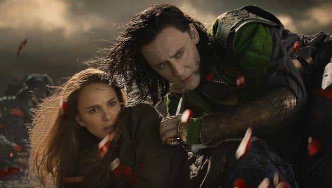 Loki (Tom Hiddleston) and Jane Foster (Natalie Portman) find themselves in a danger in 'Thor: The Dark World.'