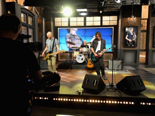 Keith Urban performs at HSN Studio on December 14,