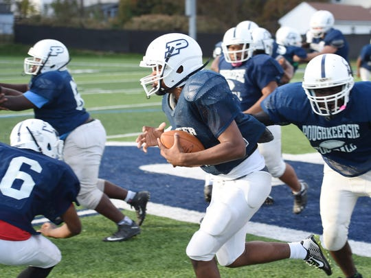 Poughkeepsie's Akili Hill carries the ball during practice at Poughkeepsie High School on Wednesday.