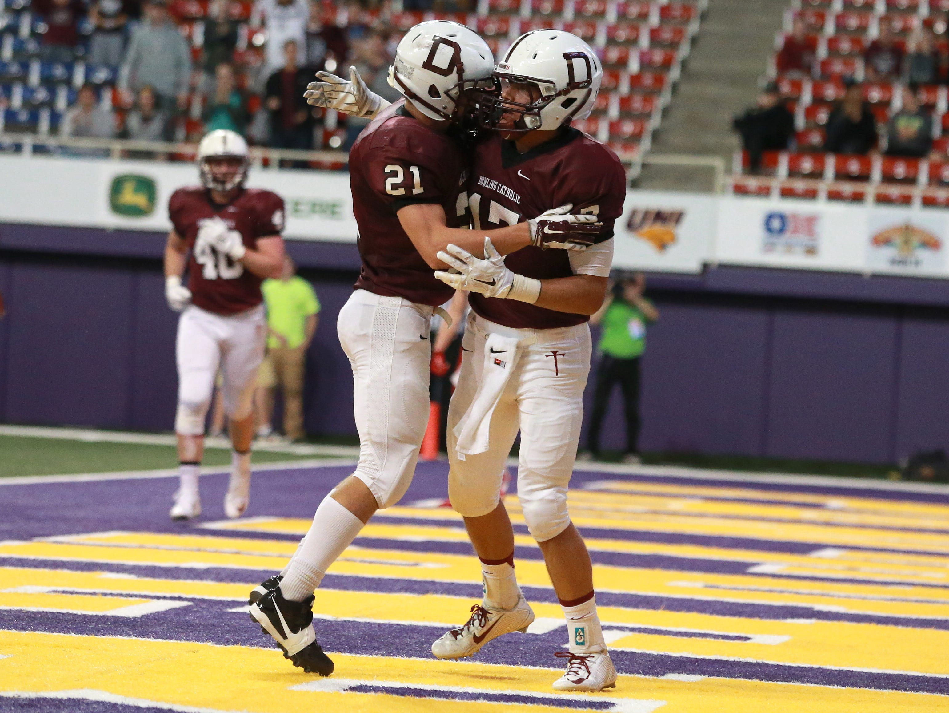 Dowling Catholic receiver Eric Fardal, right, celebrates a touchdown with Max Kasap against Cedar Rapids Washington in the Iowa Class 4A state football championship game on Friday, Nov. 21, 2014, at the UNI-Dome in Cedar Falls, Iowa.