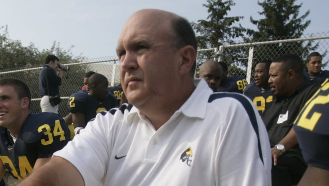 Michigan assistant coach Mike DeBord poses for a photo in 2006.