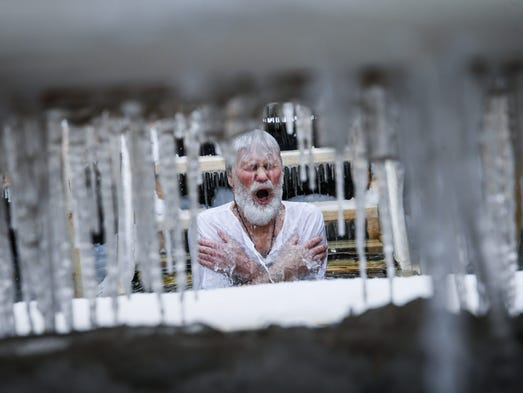 An Orthodox believer takes an icy dip in the Moskva