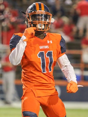 Escambia's Martin McGhee (11) looks to the sideline for instructions Thursday night at Escambia High School's Emmitt Smith Field.