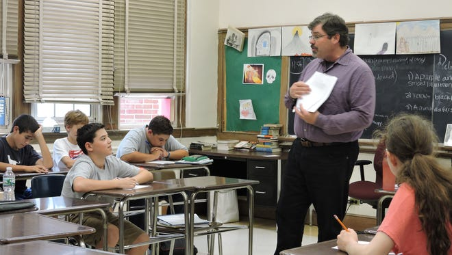 Scarsdale High School teacher Stephen Mounkhall in his classroom.
