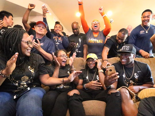 Friends and family celebrated as UTEP running back Aaron Jones was drafted by the Green Bay Packers on Saturday.