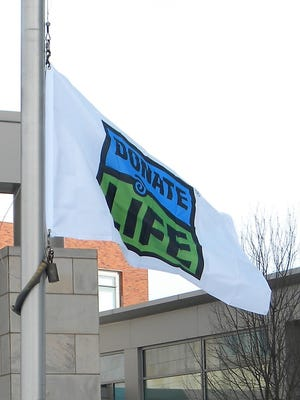 Facilities staff members at Ascension St. Clare's Hospital in Weston raise the Donate Life flag Monday, April 2, during Pause to Give Life.