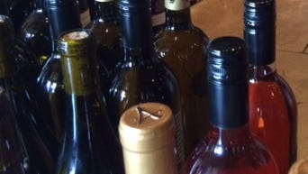 Entrants in the 2015 Arizona Republic Wine Competition wait to be judged