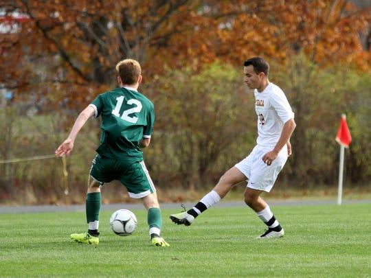 Ithaca's Michael Gualtieri  gets the ball past Yorktown's
