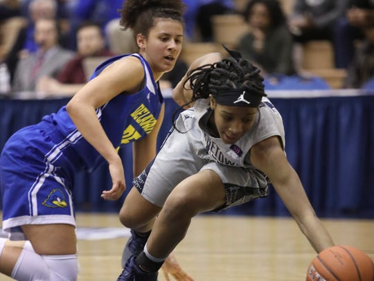 Delaware's Alison Lewis (left) tangles for a loose ball with Georgetown's Dionna White in the second half of Delaware's 67-57 loss in a first-round WNIT game at Georgetown's McDonough Arena Friday.