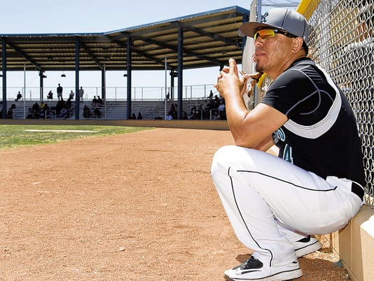 Gary Mook/For the Las Cruces Sun-News   Oñate head baseball coach David Reyes watches over his team as the Oñate Knights defeated Cibola 10-0 on Saturday at the Field of Dreams Baseball Complex in the Class 6A baseball tournament.
