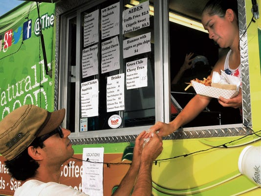 Jaime Guzman for the Sun-News      Las Crucen Alejandro Bernal ordered the Haus Burger from The Greenhaus at the Farmers Market Saturday.