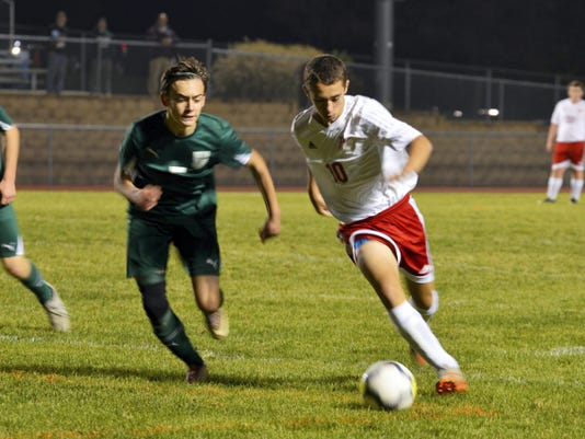Kyler Goshorn of Fannett-Metal (10) dribbles around a North Star defender during their District 5 Class A boys soccer semifinal Tuesday night at Northern Bedford. The Cougars topped F-M 4-3.