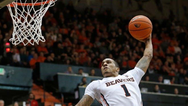 Oregon State's Gary Payton II goes for a dunk in the first half of an NCAA college basketball game against Southern California, in Corvallis, Ore., on Sunday, Jan. 24, 2016.