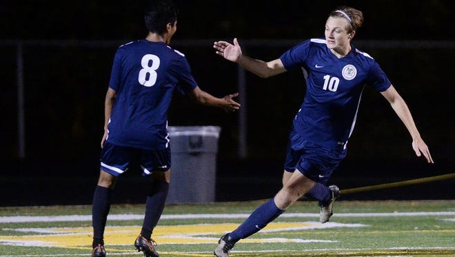 Roberson's Jack Sandstedt (10) is congratulated by Christian Chavez after scoring a goal in an October game.