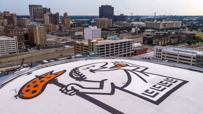 A giant Little Caesar on the roof of the new $862 million arena in Detroit.