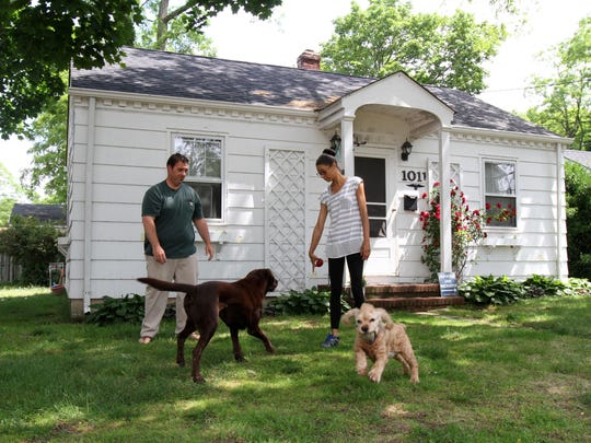 Shawn Shaughnessy and his wife, Quiavonna, play with their two dogs, Chip and Dreamer, outside their Point Pleasant home.