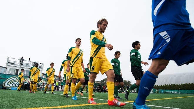 The Catamounts take the field for the starting line up introductions during the men's soccer game against Dartmouth earlier this season.
