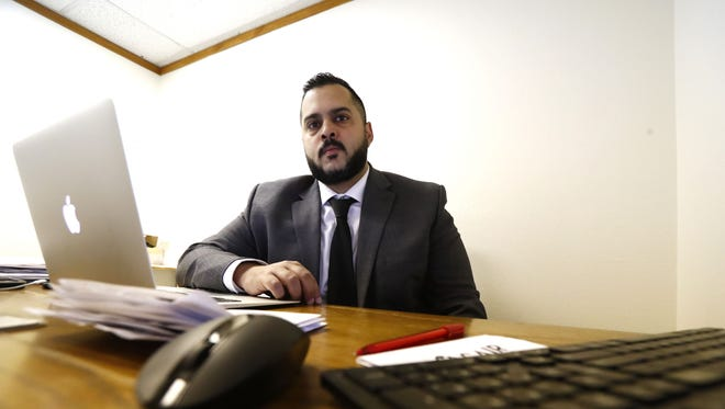 Imraan Siddiqi, the executive director of the Council on American-Islamic Relations Arizona, works at his desk in Mesa in June.