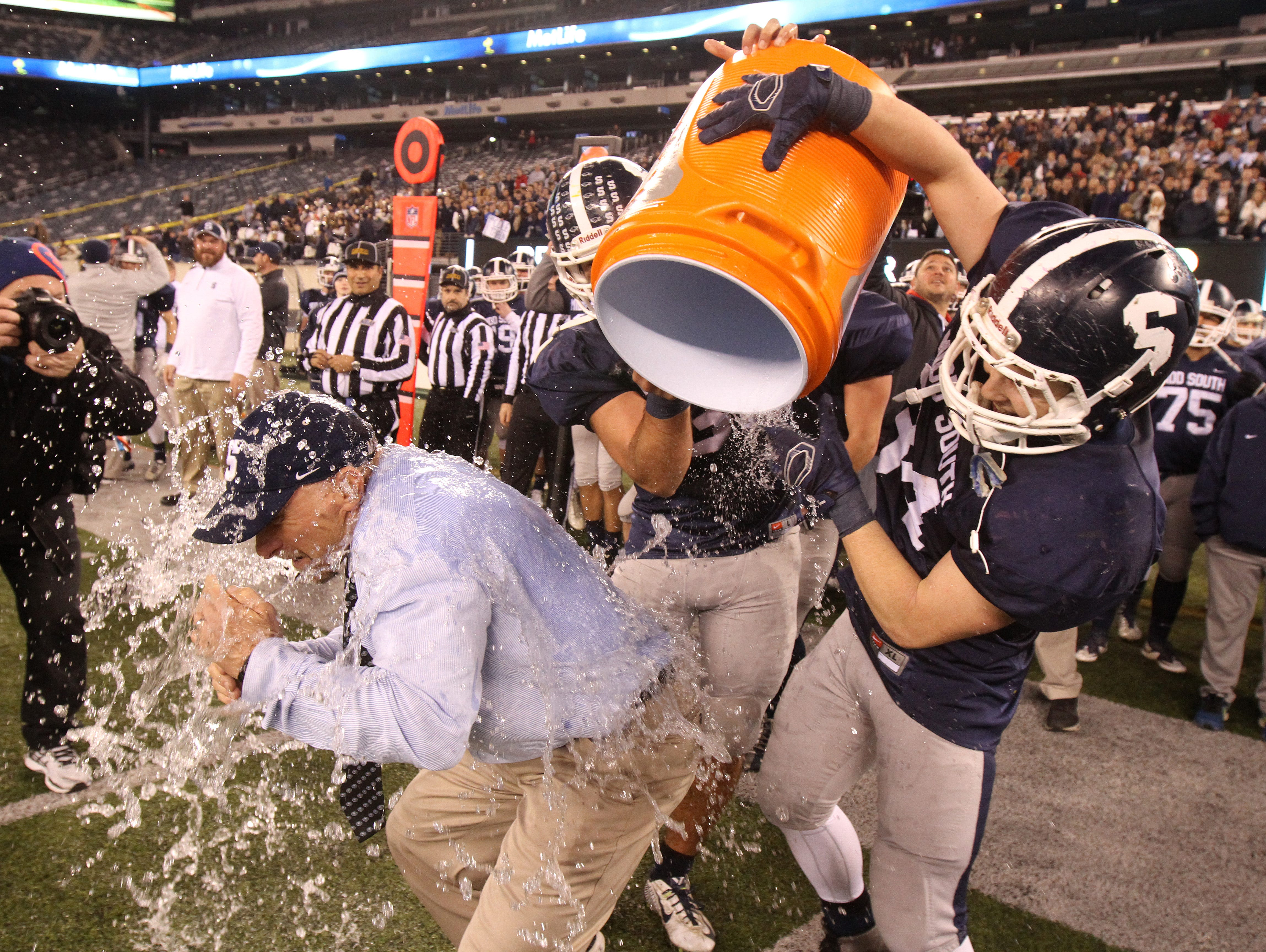 Middletown South High School players dump Gatorade on head coach Steve Antonucci after winning the state title against Phillipsburg in the North 2 Group IV game of the 2015 NJSIAA/MetLife Stadium High School Football Championships at MetLife Stadium in East Rutherford, NJ Saturday December 5, 2015.