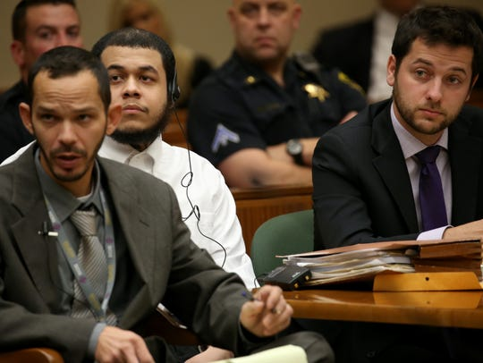 Defendant, David Alcaraz-Ubiles, listens to his lawyer