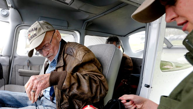 Vietnam War Veteran Jack Allen boards the plane and starts to buckle up for his 89th birthday surprise plane flight as pilot Caroline Wright gets his head set ready for him on Friday, April 6, 2018.