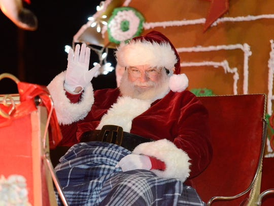 Santa Claus visits the Marshall Christmas parade Monday night