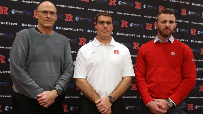 Rutgers coach Chris Ash (center) hired defensive coordinator Jay Niemann (left) and offensive coordinator Drew Mehringer (right) at $450,000 per year apiece.