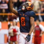 Syracuse reciever Steve Ishmael celebrates a touchdown during the Orange's 24-17 loss to North Carolina State on Saturday.