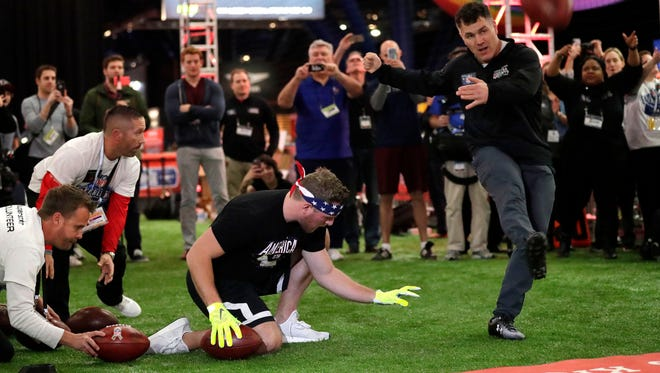 Four-time Super Bowl champion Adam Vinatieri kicks one of a record setting 28 field goals in 60 seconds during The NFL Extra Points Kick and Guinness World Records attempt at the NFL Experience in Houston.