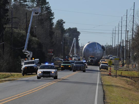Utility lines had to be moved and other traffic accommodations had to be made for movement of the contained burn chamber's trip to Camp Minden where it arrived on Thursday. It will be used to dispose of about 16 million pounds of M6 propellant and Clean Burning Igniter.
