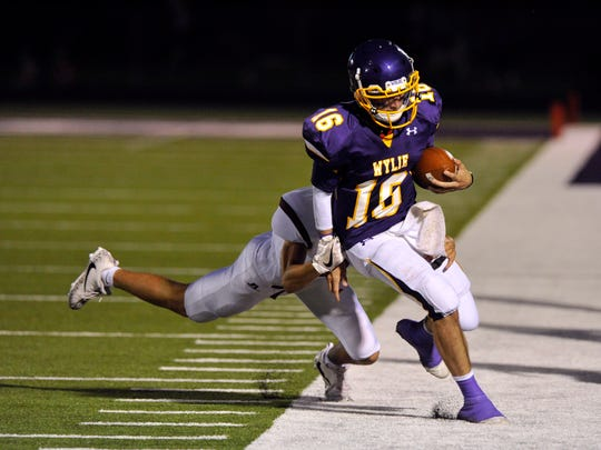 Wylie High School quarterback Sam King steps out-of-bounds as Vernon's Nolan Chavez attempts a tackle during Friday's game in Abilene Sept. 1, 2017.