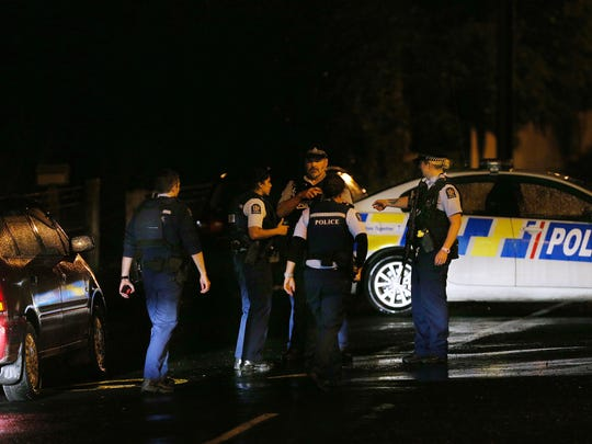 DUNEDIN, NEW ZEALAND - MARCH 15: Police investigate