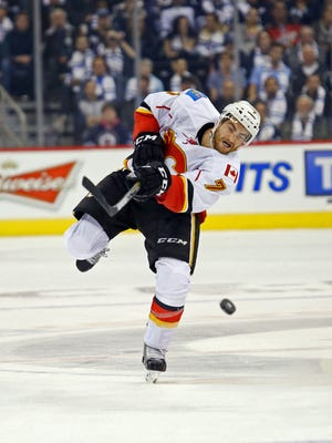 Calgary's T.J. Brodie leads league defensemen with seven points.