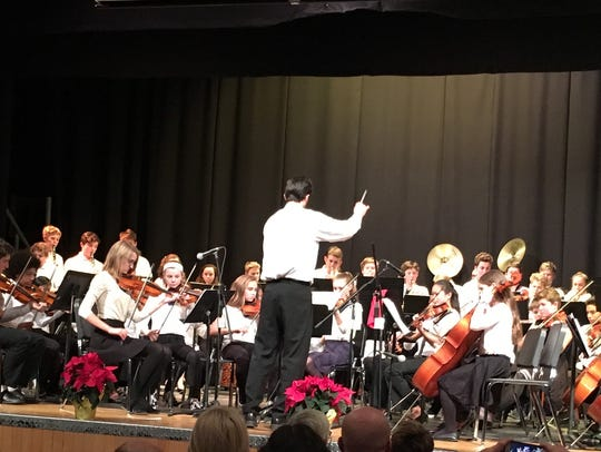 Orchestra Director Michael Hakim leads student musicians