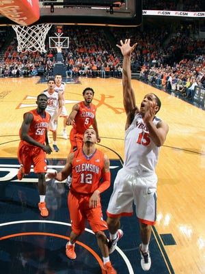 Virginia guard Malcolm Brogdon (15) shoots in front of Clemson guard Avry Holmes (12) during an NCAA college basketball game Tuesday Jan. 19, 2016, in Charlottesville.