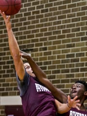 Riverdale High School's Jacob Tracey goes up for a shot over teammate Jaquez Dickerson during practice Tuesday afternoon (02/10/16).