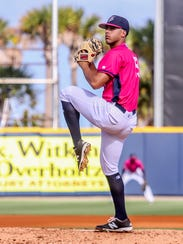 Pensacola's Jose Lopez (19) pitches against the Mississippi