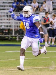 UWF's Martes Wheeler (19) runs off the field celebrating