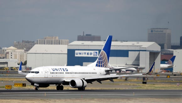 A United Airlines plane lands at Newark Liberty International