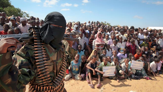 An armed member of the militant group al-Shabab attends a rally on the outskirts of Mogadishu, Somalia, on Feb. 13, 2012.