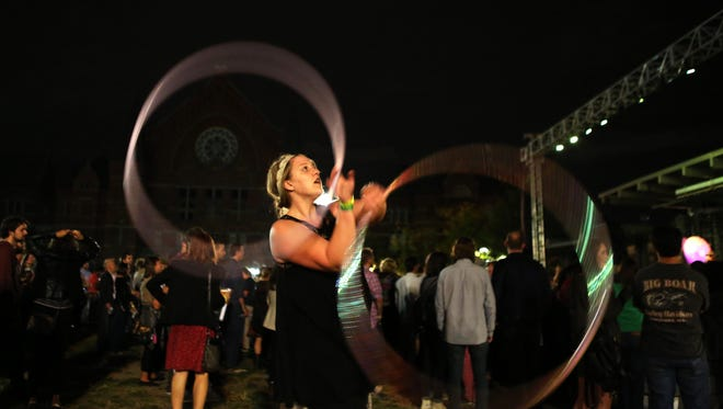 Liberty Lord of Dayton hula hoops during HANA's performance on Friday.