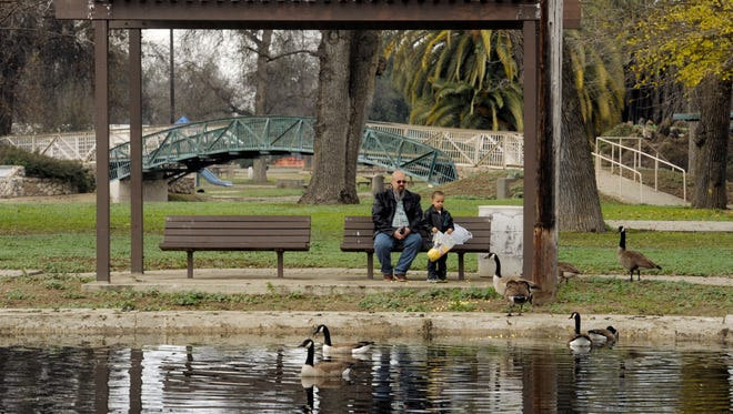 Doug Terry and his grandson, Daniel, 4, both of Farmersville, spend the morning outside at Mooney Grove Park feeding the geese.