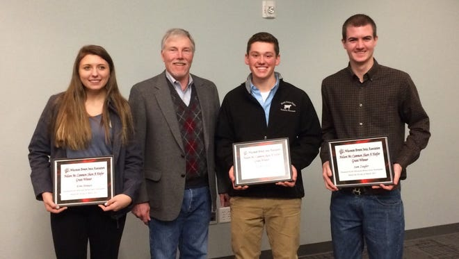 Las year's winners from the Share a Heifer program are (from left) Erin Strauss, Lake Mills, Norman Magnussen Committee member, Joey Opsal, Blue Mounds and Sam Ziegler, Freedom.