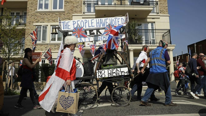 """Pro-Brexit leave the European Union supporters take part in the final leg of the """"March to Leave"""" in London, Friday, March 29, 2019. The protest march which started on March 16 in Sunderland, north east England, finishes on Friday March 29 in Parliament Square, London, on what was the original date for Brexit to happen before the recent extension. (AP Photo/Matt Dunham)"""
